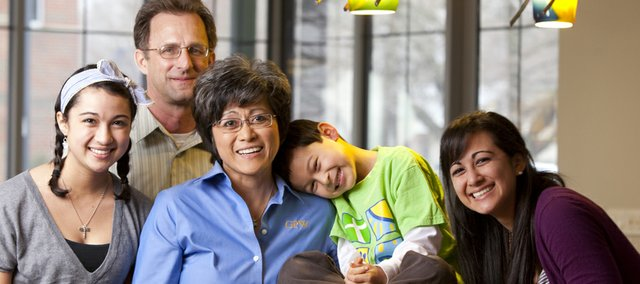 Gina Pacumbaba-Watson, president and chief executive officer of GPW, is pictured with her three children Sydney, 15, left;  Jack, 6, smf Maria, 16, and her husband, Karl Watson, who works as chief financial officer for GPW. Pacumbaba-Watson started the engineering firm GPW, which is in its 13th year in operation.