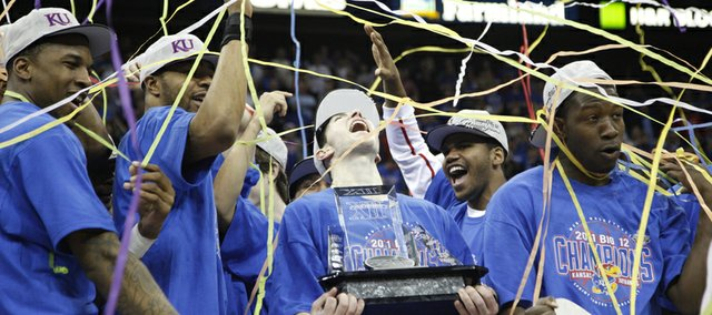 The Kansas Jayhawks are covered in streamers following their win over Texas on Saturday, March 12, 2011 at the Sprint Center.