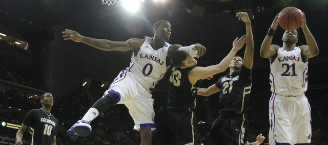 Things get physical down low between Kansas players Thomas Robinson (0) and Markieff Morris (21) and Colorado defenders Austin Dufault (33) and Andre Roberson (21) during the first half on Friday, March 11, 2011 at the Sprint Center.