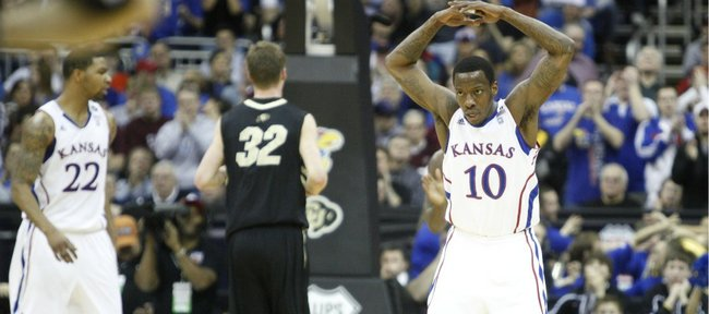 Kansas guard Tyshawn Taylor gets the crowd to its feet after Jayhawk run against Colorado during the first half on Friday, March 11, 2011 at the Sprint Center.