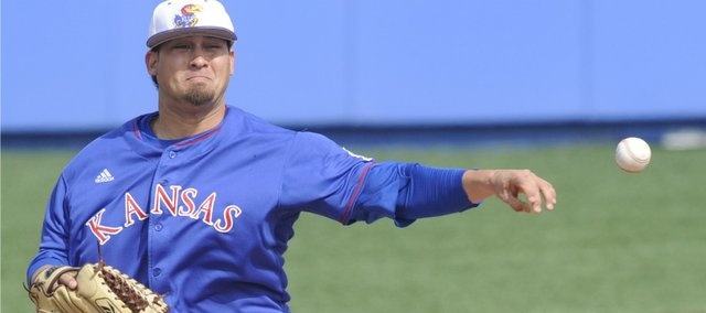 Kansas Pitcher Wally  Marciel (8) attempts a pickoff move toward first base. KU was hammered, 8-1, by Eastern Michigan on Saturday at Hoglund Ballpark.