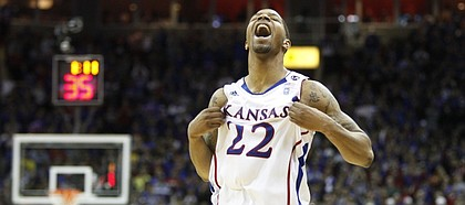 Kansas forward Marcus Morris puffs his jersey with little time remaining against Texas during Big 12 championship.