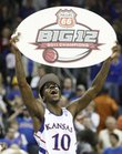Kansas guard Tyshawn Taylor hoists a Big 12 champions sign following the Jayhawks' win over Texas on Saturday, March 12, 2011 at the Sprint Center.