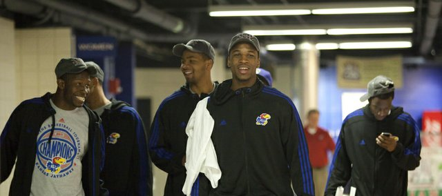Kansas players from left, Mario Little, Travis Releford, Marcus Morris, Thomas Robinson, front, and Tyshawn Taylor laugh as they walk around the fieldhouse concourse following the NCAA tournament selection show on Sunday, March 13, 2011.
