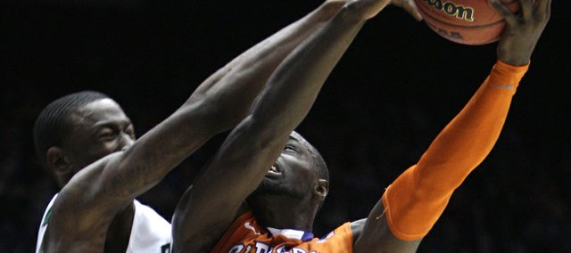 Clemson center Jerai Grant (45) shoots against UAB forward Cameron Moore in the first half of a first-round NCAA Tournament game on Tuesday, March 15, 2011, in Dayton, Ohio.