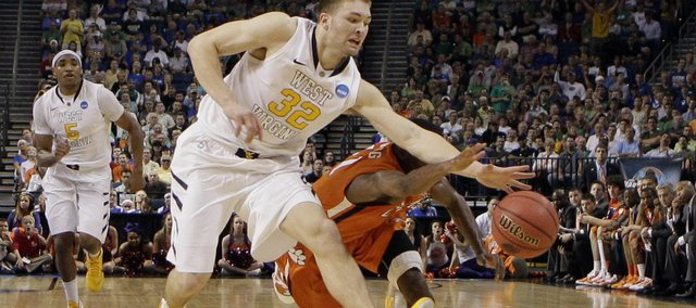 West Virginia's Dalton Pepper (32) and Clemson's Andre Young go after a loose ball during the second half of an East regional second round NCAA tournament game in Tampa, Fla., Thursday, March 17, 2011. West Virginia defeated Clemson 84-76.