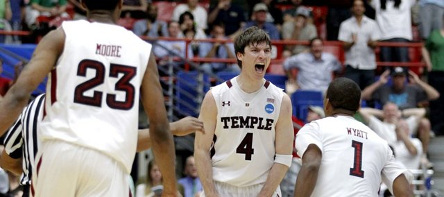 Temple's Juan Fernandez, middle, celebrates his winning basket with Khalif Wyatt, right, and Ramone Moore during a West Regional second round game against Penn State in Tucson, Ariz. Thursday, March 17, 2011. Temple won 66-64.