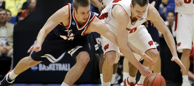 Belmont's Brandon Baker, left, and Wisconsin's Jon Leuer battle for the ball during a Southeast Regional NCAA college basketball tournament second-round game Thursday, March 17, 2011, in Tucson, Ariz. Wisconsin went on to win 72-58.