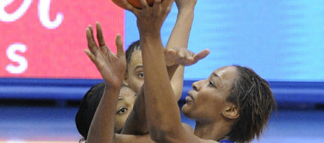 Kansas University forward Carolyn Davis rises for two points in the second half against Wichita State in the first round of the WNIT. Davis dominated the post, scoring 33 points in KUs 79-58 throttling of the Shockers on Wednesday in Allen Fieldhouse.