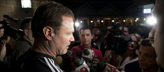 Kansas University coach Bill Self speaks with media members after arriving at the Renaissance Hotel in Tulsa, Okla.