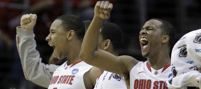 Ohio State's Jared Sullinger (0) and William Buford (44) cheer from the bench in the second half of an East regional NCAA college basketball tournament second round game against Texas-San Antonio Friday, March 18, 2011, in Cleveland.