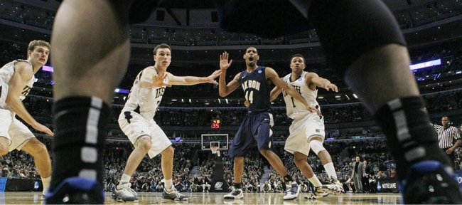 Notre Dame defenders Ben Hansbrough, center left, and Tyrone Nash (1) cover Akron's Zeke Marshall (44) on an in bounds pass in the second half of a second-round NCAA Southwest Regional tournament college basketball game in Chicago, Friday, March 18, 2011. At left is Notre Dame's Tim Abromaitis. Notre Dame won 69-56.
