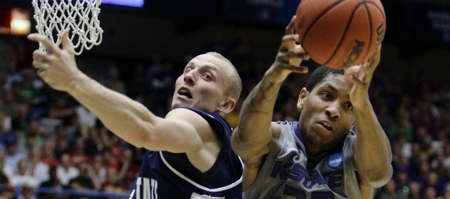Kansas State's Rodney McGruder (22) grabs the rebound after a missed shot by Utah State's Brady Jardine during a Southeast Regional NCAA college basketball tournament second-round game Thursday, March 17, 2011, in Tucson, Ariz.