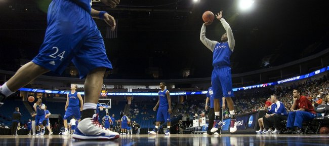 Kansas guard Tyshawn Taylor puts up a three from the corner as the Jayhawks work out before their fans during a day of practices and press conferences for teams playing second and third round games in Tulsa on Thursday, March 17, 2011 at the BOK Center.