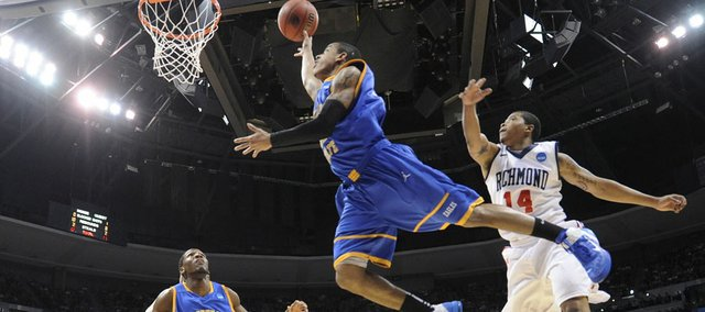 Morehead State guard Terrance Hill (11)goes up for a shot against Richmond guard Kevin Anderson (14) in the first half of a Southwest regional third round NCAA tournament college basketball game, Saturday, March 19, 2011, in Denver.