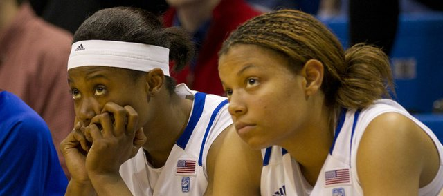 Kansas senior guard Marisha Brown, left, and freshman guard Diara Moore watch the closing minutes of Kansas' 80-63 loss to Duquesne on Saturday, March 19, 2011 at Allen Fieldhouse.