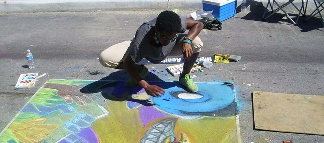 Kansas City Hip Hop Academy member finishing a chalk drawing at the Kansas City Chalk and Walk Street Festival. This week, members of the academy will offer alternative dance classes at the Lawrence Arts Center, 940 N.H.