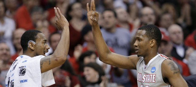 Ohio State's David Lighty, left, celebrates a 3-point shot by William Buford, right, in the second half of an East regional NCAA college basketball tournament third-round game against George Mason on Sunday, March 20, 2011, in Cleveland.
