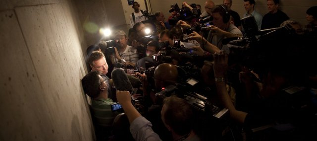 Kansas head coach Bill Self takes questions from media members about preparing to play Illinois, where he served as head coach before coming to KU, on Saturday, March 19, 2011 outside the team's locker room at the BOK Center in Tulsa.
