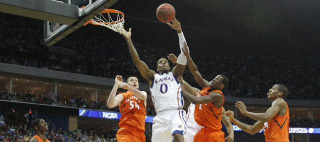 Kansas forward Thomas Robinson battles inside for a rebound with the Illinois defense during the first half on Sunday, March 20, 2011 at the BOK Center in Tulsa.