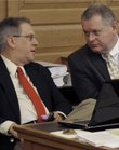 Kansas state Reps. Clark Shultz, left, a Lindsborg Republican, and Doug Gatewood, right, a Columbus Democrat, confer during a House Appropriations Committee meeting, Monday, March 21, 2011, at the Statehouse in Topeka.