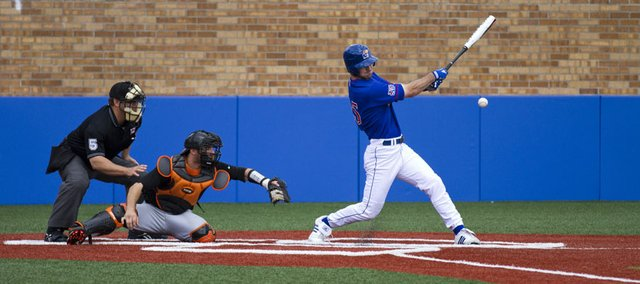 Kansas outfielder Casey Lytle delivers a hit during the first game of a doubleheader against Oklahoma State. The Jayhawks swept the Cowboys on Sunday at Hoglund Ballpark.