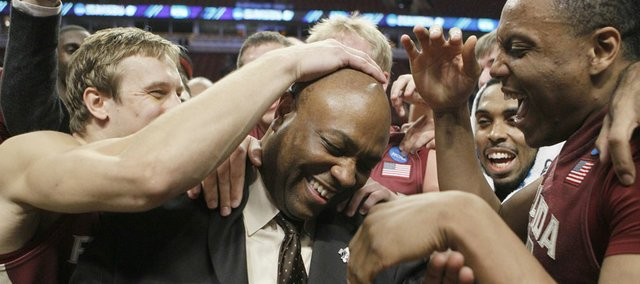 Florida State players rub head coach Leonard Hamilton's head after a third-round NCAA Southwest Regional tournament college basketball game in Chicago, Sunday, March 20, 2011. Florida State won 71-57.