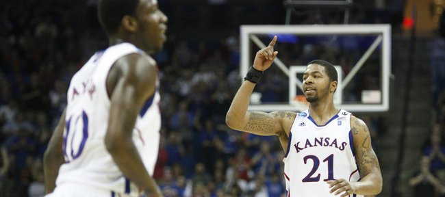"Kansas forward Markieff Morris twirls his finger for the ""wrap-up"" signal after an alley-oop dunk against Illinois during the second half on Sunday, March 20, 2011 at the BOK Center in Tulsa."