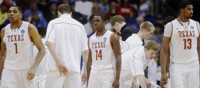 Texas players including Gary Johnson (1), J'Covan Brown (14) and Tristan Thompson (13) return to the court after a timeout against Arizona during the second half of a West Regional NCAA tournament third-round college basketball game on Sunday, March 20, 2011, in Tulsa, Okla.
