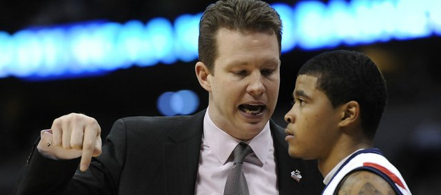 Richmond coach Chris Mooney, left, talks with guard Kevin Anderson against Morehead State on Saturday, March 25, 2011 in Denver.