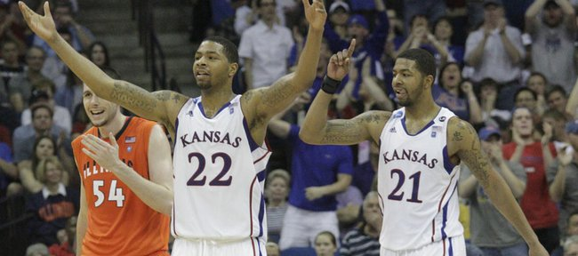 Kansas forwards Marcus (22) and Markieff Morris get the crowd to its feet after a bucket during the second half of KU's 72-59 win against Illinois on Sunday, March 20, 2011 at the BOK Center in Tulsa, Okla.