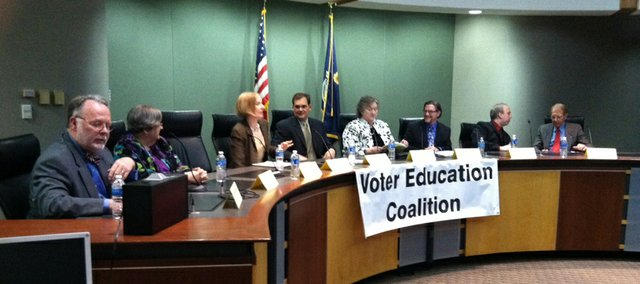 From left, Jim Clark, Ola Faucher, Shannon Kimball, Randy Masten, Marlene Merrill, Keith Diaz Moore, Tyler Palmer and Bill Roth participate in a Voter Education Coalition forum for Lawrence school board candidates Tuesday, March 22, 2011.