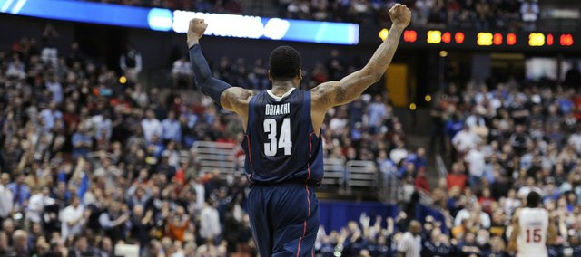 Connecticut's Alex Oriakhi (34) reacts after Connecticut's 74-67 win over San Diego State in a West regional semifinal in the NCAA college basketball tournament, Thursday, March 24, 2011, in Anaheim, Calif.