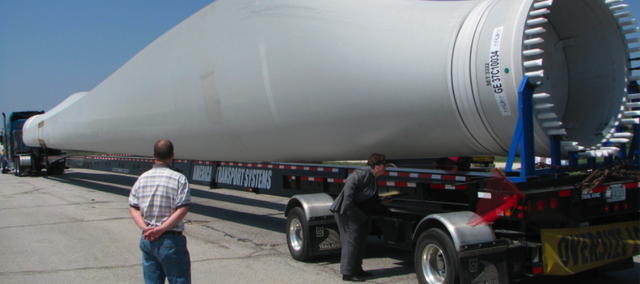 Giant blades are among the pieces of oversized equipment trucked throughout Kansas to meet the state and region's booming wind industry demands. This blade was at the westbound weigh station on Interstate 70 near the Kansas State Highway 99 interchange