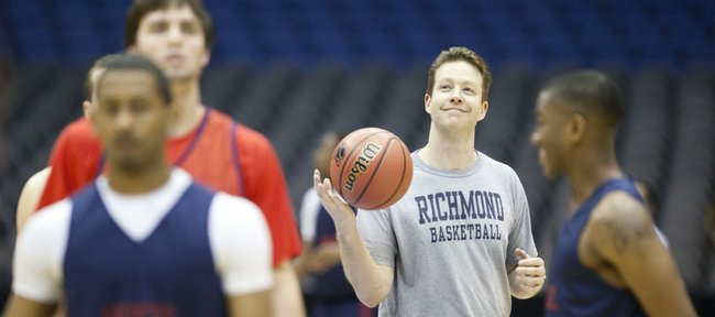 Richmond head coach Chris Mooney flips the ball around as he watches the Spiders run drills during a day of practices and press conferences at the Alamodome in San Antonio on Thursday, March 24, 2011.