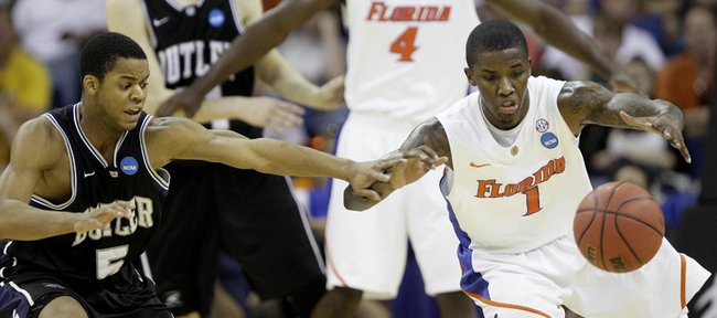 Florida's Kenny Boynton (1) battles for a loose ball against Butler's Ronald Nored (5) during the second half of the NCAA Southeast regional college basketball championship game Saturday, March 26, 2011, in New Orleans.