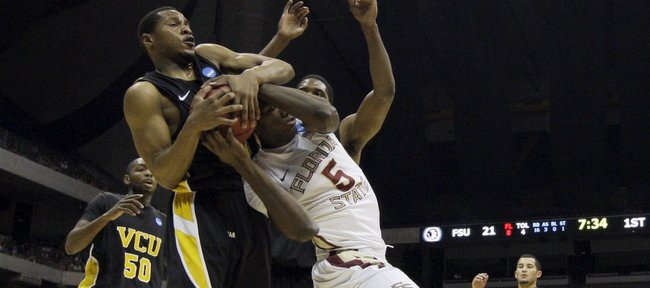Virginia Commonwealth's Bradford Burgess pulls the ball away from Florida State's Bernard James during the first half of a Southwest regional semifinal game in the NCAA college basketball tournament Friday, March 25, 2011, in San Antonio.