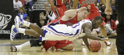 Mario Little (23) scrambles for a loose ball during the first half against the Richmond Spiders Friday, March 25, 2011 at the Alamodome in San Antonio.