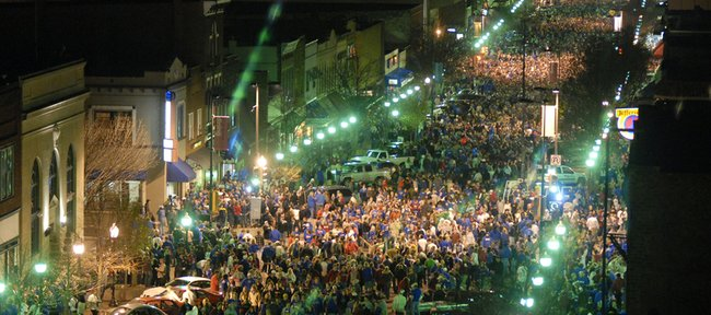 In this April 7, 2008 file photo, an estimated 40,000 people celebrate on Massachusetts Street in downtown Lawrence after the Kansas Jayhawks defeated the Memphis Tigers to win the 2008 NCAA National Championship title.