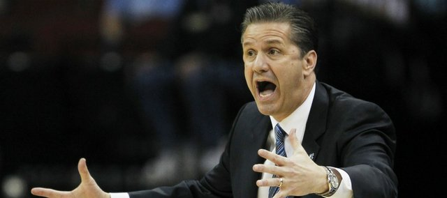 Kentucky coach John Calipari gestures during the first half of the final of the NCAA men's college basketball tournament East regional against North Carolina, Sunday, March 27, 2011, in Newark, N.J.