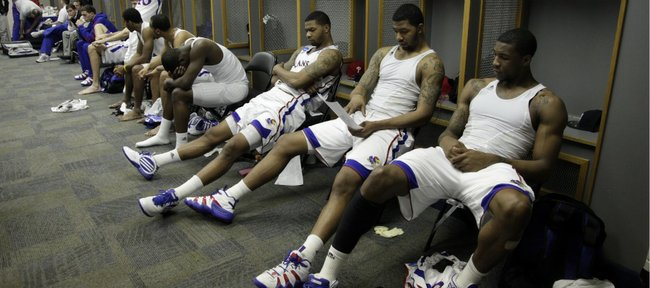 The Kansas Jayhawks sit in a somber locker room following their 71-61 loss to Virginia Commonwealth on Sunday, March 27, 2011 at the Alamodome in San Antonio.