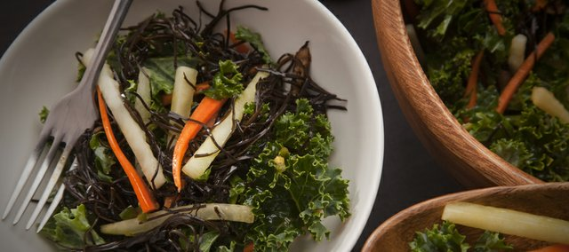 Kale salad is a alternative choice in spring salads other than iceberg or romaine leaves. This is a marinated kale salad that uses a mixture of tamari and lemon juice to soften the normally tough green kale leaves.