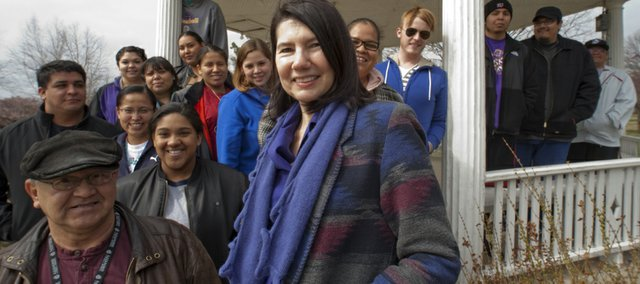 Lucia Orth, center, teaches Indigenous American Indian Studies at Haskell Indian Nations University. She was gathered with her American Indian Treaties class for a photo session.