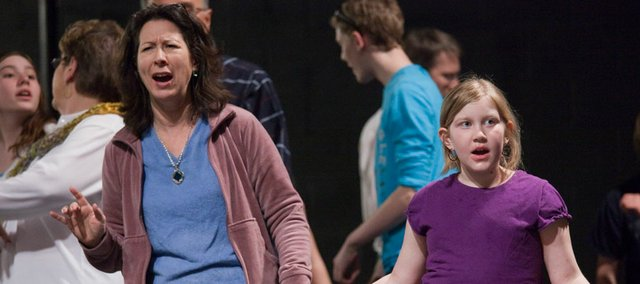 """Emma Silvestri, 9, right, rehearses for the upcoming show """"Music Man"""" at the Lawrence Arts Center. She is in the musical along with her father Tony."""