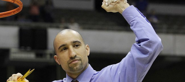 Virginia Commonwealth coach Shaka Smart celebrates after his team won the NCAA Southwest regional final against Kansas University on Sunday in San Antonio. Smarts grandfather died on Tuesday.