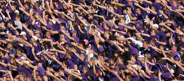 Kansas State fans wave their arms during a 2009 football game against Kansas University. K-State has mapped out a game plan for helping Manhattan win the Take Charge Challenge against Lawrence.