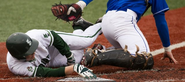 Free State's Dane McCullough beats a throw to the plate and scores a run against Leavenworth. Free State upended Leavenworth, 4-2, on Thursday, March 31, 2011 at FSHS.