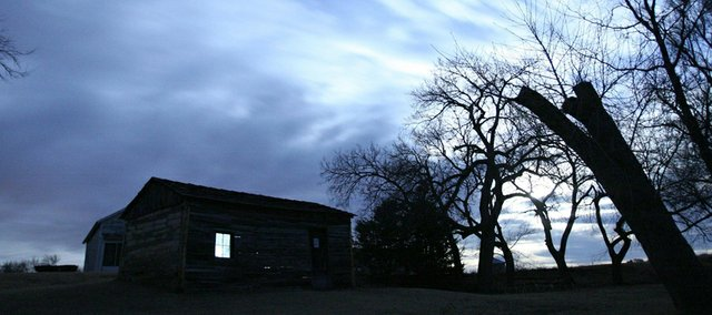 "Brewster Higley's cabin against the night sky. The cabin, where Higley wrote the lyrics to ""Home on the Range,"" is listed on the National Register of Historic Places."