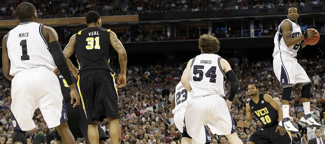 Butler's Shawn Vanzant grabs a rebound against Virginia Commonwealth during the second half of a men's NCAA Final Four semifinal college basketball game Saturday, March 2, 2011, in Houston.