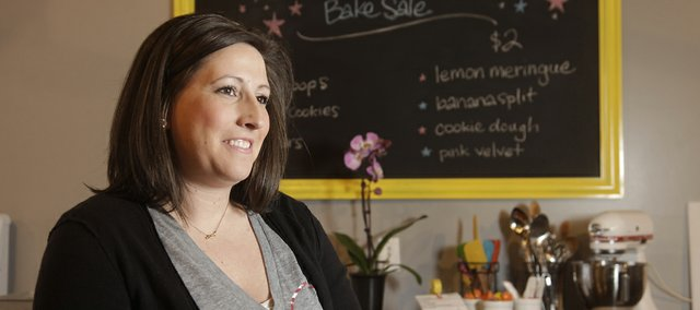 Cami SanRomani is the owner of Cami's Cake Co., a bakery with a storefront in downtown Eudora. Her husband, Dustin, worked three jobs so she could get her business off the ground. Today, her schedule is filled with private events, charitable fundraisers and wedding cake tastings.